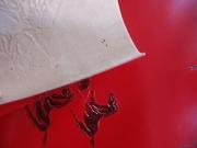 Täschner-Leder, rot mit geprägtem Pferdemotiv, zugfest